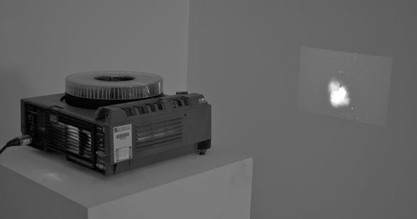 <i>The air we breathe</i> Installation with slide projector, slides, sound, 2011